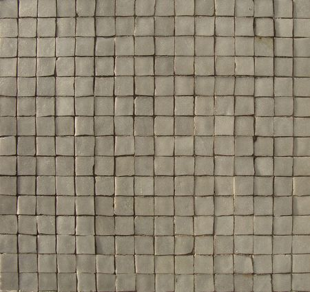 white gray mosaic pattern on a wall with some depth