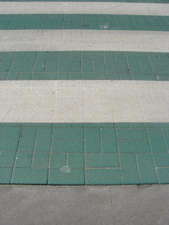 green road pavement with white zebra-path photo