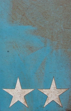 2 white stars on a grungy rusty metal blue surface photo
