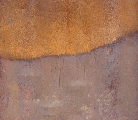 industrial orange metal surface with rust mark                                photo