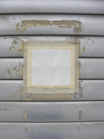 white poster with tape on grunge roller shutter Stock Photo - 9790926