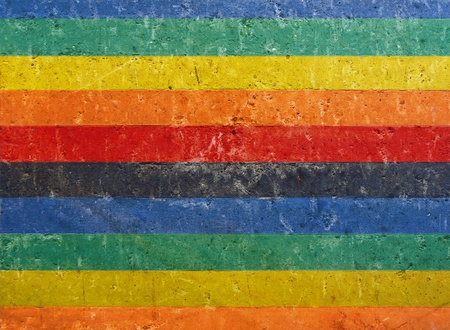 grunge concrete wall painted in many colors                                Stock Photo