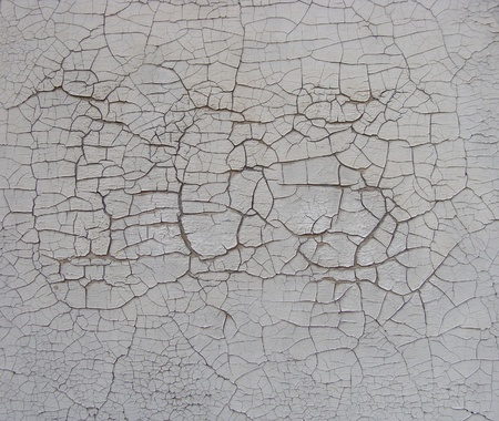 subtle cracked paint pattern on white wall