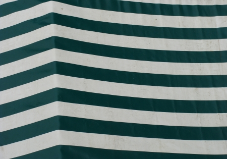 striping: striped sail cover for market place stand in green Stock Photo