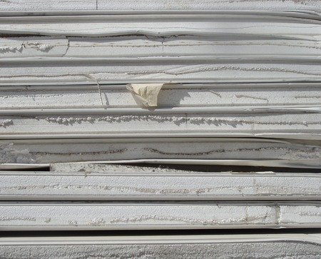 demolish: stacked industrial isolation foam on a demolition site Stock Photo