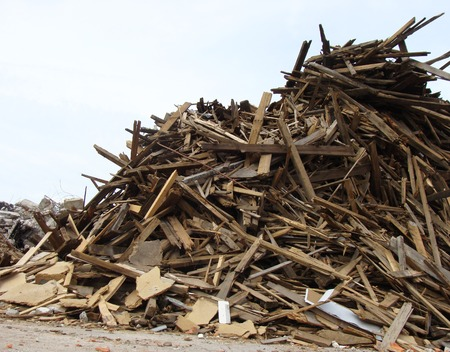 large pile of wood on a demolition site