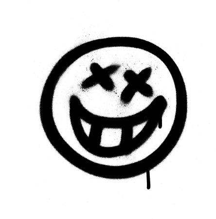 Graffiti-emoji met een grijns gespoten in zwart op wit