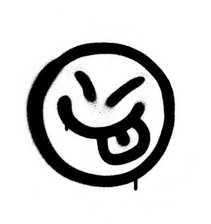 Graffiti happy emoji sprayed in black on white