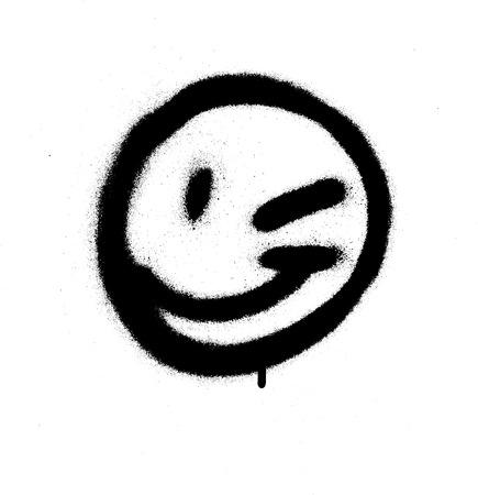Graffiti emoticon knipoog gezicht gespoten in zwart op wit