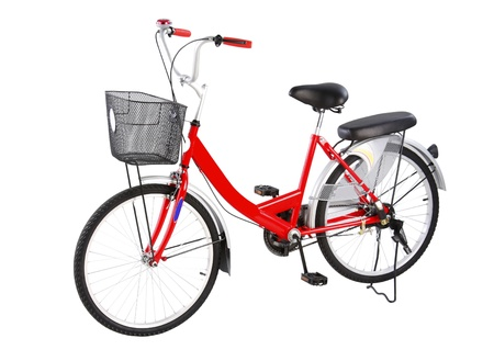 Red housewife style bicycle isolated on white background  photo