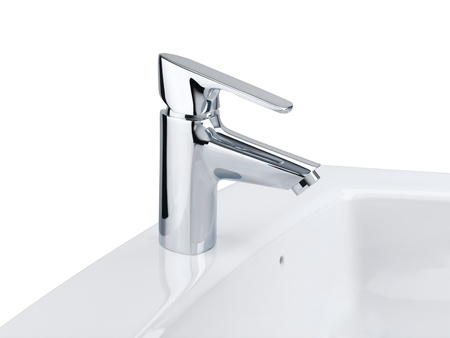 Nice design of the chrome faucet and white washbasin isolates on white  photo
