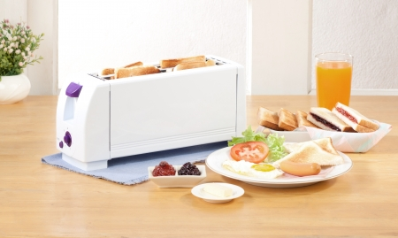 Bread toaster the neccessary kitchen tool  Stock Photo