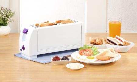 Bread toaster the neccessary kitchen tool  Stock Photo - 15671647