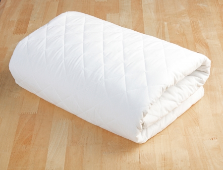 Bed sheet mattress cover isolated on the wooden floor Stock Photo - 15671653