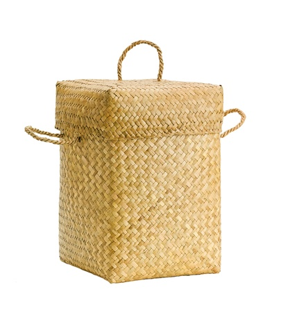 Cute design bamboo basket for keeping cloths after used or others purpose isolates  photo