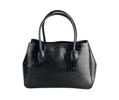 Beautiful black leather handbag made from crocodile leather isolates on white   photo
