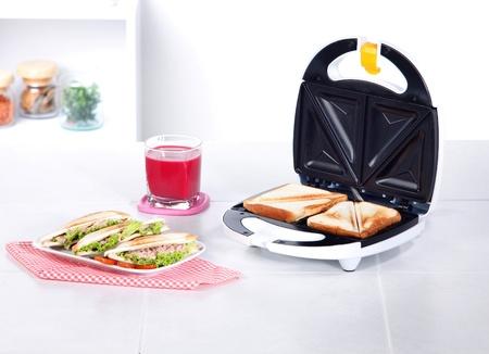maker: sandwich maker machine in the kitchen