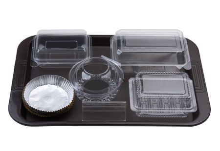 Tray of empty bakery plastic package utensils for storage bread cookie bun or cake photo