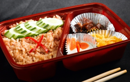 Thai fried rice with salted pork egg and dessert mix and ready to eat in the lunchbox photo