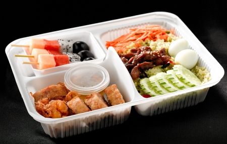 Ready made to eat asian  thai styel rice box full of ingredients photo