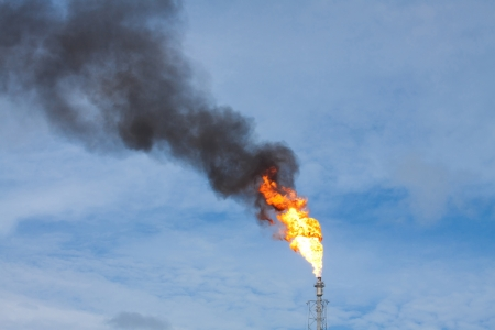 propane tank: Smokestack draining fuel and gas into the are caused by error in the productions systems these may be pollution and global warming situation of the planet Stock Photo
