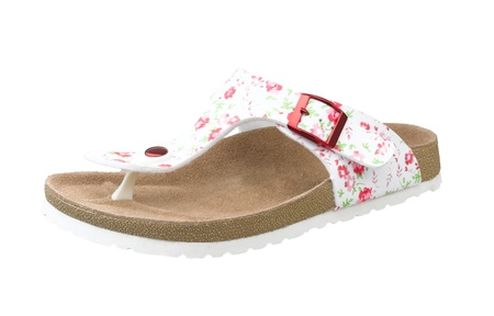 Beautiful woman leather sandal with flower pattern isolated photo