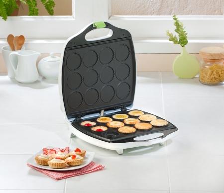 machine made: Cupcake ot tart maker machine in the kitchen