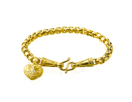 Golden bracelet with heart shape  photo