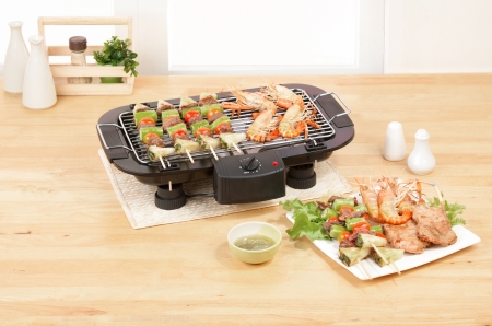 electric stove: Electric appliance barbecue grill in the kitchen Stock Photo