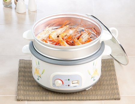 rice cooker: Shrimp seafood in the steaming pot ready to eat