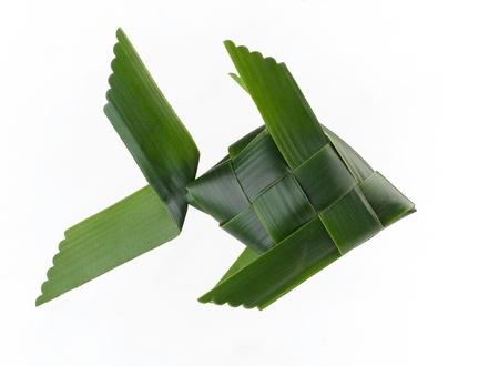 fish toy: Pesce giocattolo realizzato in foglia di noce di cocco � giocattolo per i bambini isolati