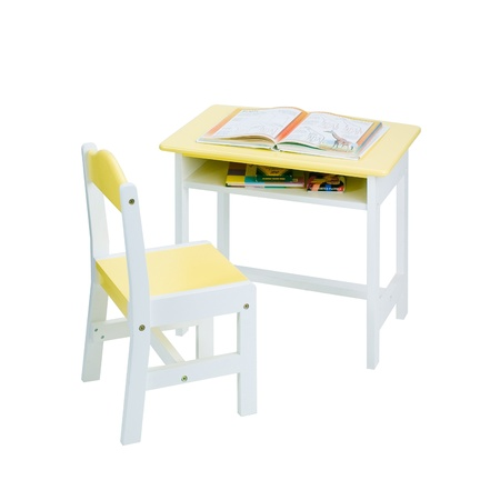 Beautiful wooden yellow chair and desk for kids photo