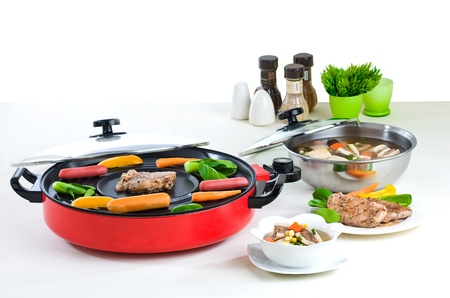 double oven: Electric barbecue and cooking pot a useful kitchenware Stock Photo