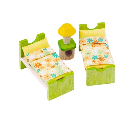 dormitory: Tiny wooden bed toy furniture for children learning to decorates bedroom Stock Photo