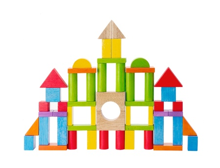 Colorful wooden toy castle on white  photo