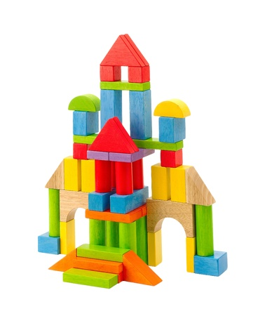 wood blocks: Colorful toy castle built from the wood blocks isolates  Stock Photo