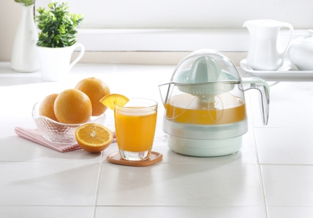 Orange juice blender tool in the kitchen Stock Photo - 16446463
