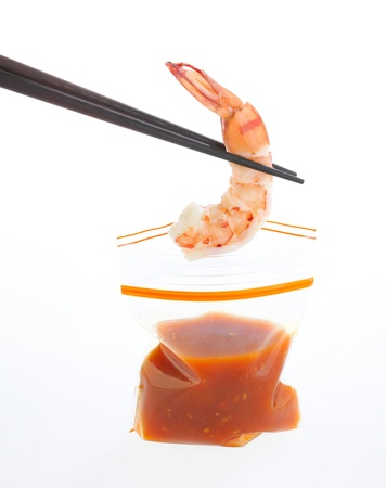 Shrimp and sauces in zipper bag isolated  Stock Photo - 16654236