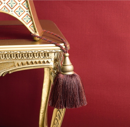 cute design of tassel on the golden chair Stock Photo - 16801578