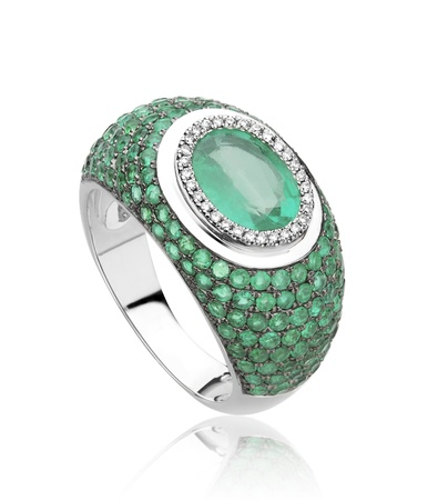 fashion jewelry: Luxury emerald ring decorated by diamonds  Stock Photo