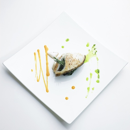 Grilled snow fish steak with steamed spinach photo