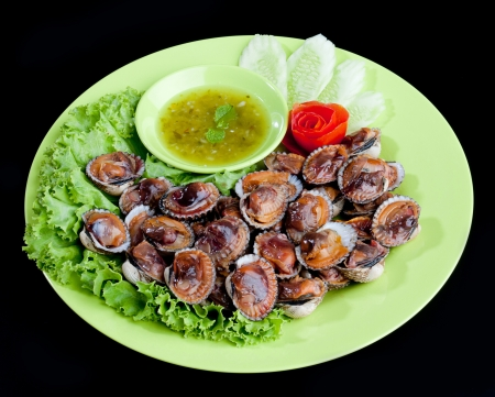 cockle: Grilled cockles seafood serves with spicy seasoning sauces Stock Photo