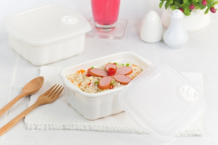 fried rice with sausages in the clear microwave box ready to eat photo