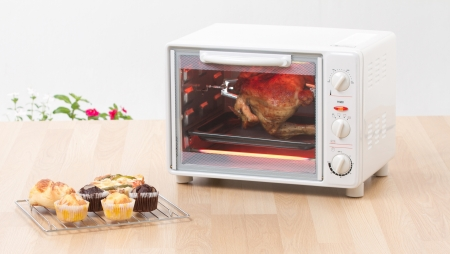 Electric chicken grill or roaster oven fast and convenience to cooking Stock Photo - 16984581