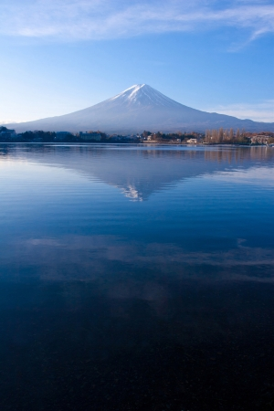 snow capped mountain: Mt Fuji reflection from sky to lake in early autumn, Japan Stock Photo