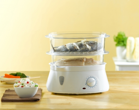 The multiple purpose of electric steaming pot for your food cooking photo