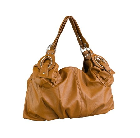 Nice and beautiful brown lady leather handbag isolated photo