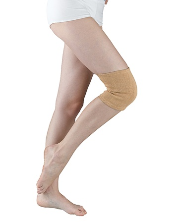 knees bent: Knee support for relieve your pain isolated on white   Stock Photo