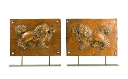 a pair brass old lion sculpture that telling an ancient story from Tibet Stock Photo - 17584746