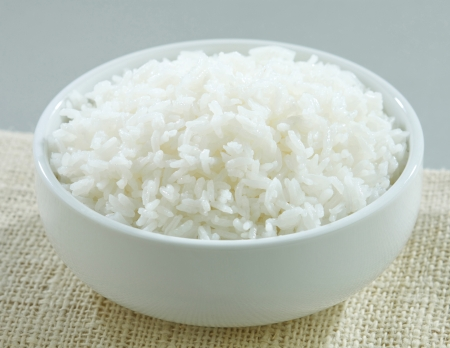 jasmine rice: Jasmine rice in a rice bowl isolated  Stock Photo